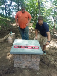 Leveling the bluestone cap.