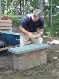 Jimmy setting the bluestone caps.